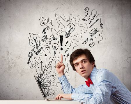 Young thoughtful man using laptop  Idea concept photo