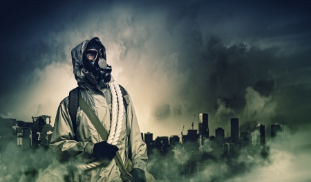 Man in gas mask against disaster background  Pollution concept Фото со стока