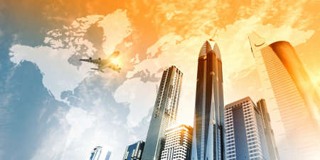 business travel: Plane flying above skyscrapers  Business travel concept Stock Photo
