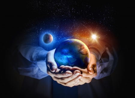 holding close: Close up image of human hands holding earth planer  Ecology concept