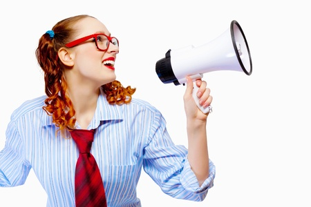 Young funny woman in red glasses holding megaphone photo