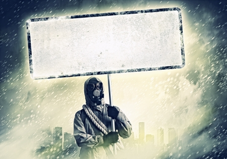 Stalker in gas mask with blank banner  Disaster concept Stock Photo - 21789507