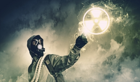Man in respirator against nuclear background touching symbol  Pollution concept Stock Photo - 21789613