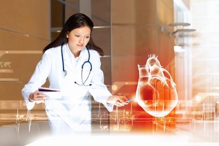 pulmology: Image of attractive woman cardiologist examining virtual heart