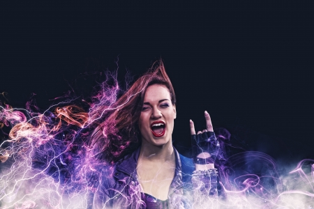 Rock passionate girl with black wings and color background Stock Photo