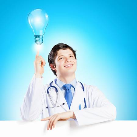 Young smiling doctor with blank banner  Place for text photo