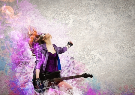 Rock passionate girl with black wings and color background photo