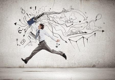 Image of businessman in jump against sketch background photo