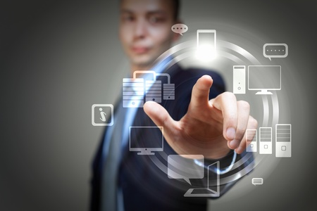 technology metaphor: Business person pushing symbols on a touch screen interface