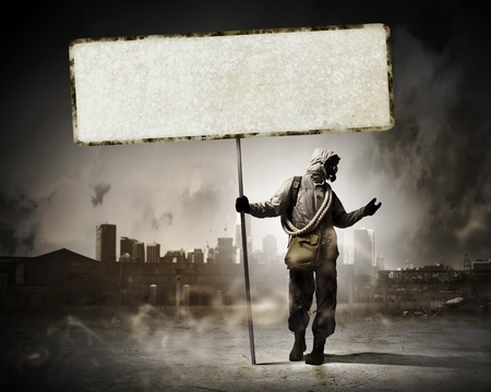 Image of stalker with blank banner against nuclear future Stock Photo - 21978312