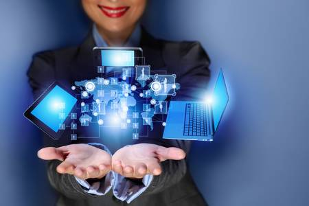 Close up image of businesswoman with 3d images of devices in her hands photo