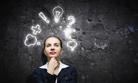 Image of thoughtful businesswoman looking at light bulb photo