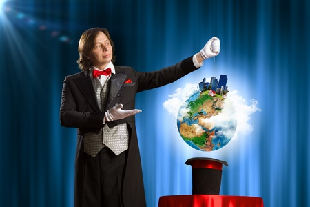 Image of wizard showing tricks with his hat  Ecology concept  Elements of this image are furnished by NASA