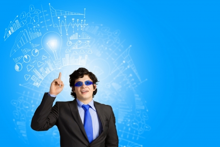 Image of young businessman wearing goggles  Idea concept photo