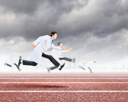 Funny image of young running doctor in white uniform photo