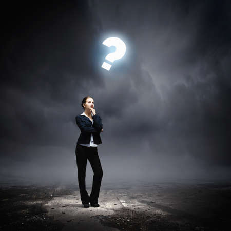 Image of concentrated businesswoman looking for answer