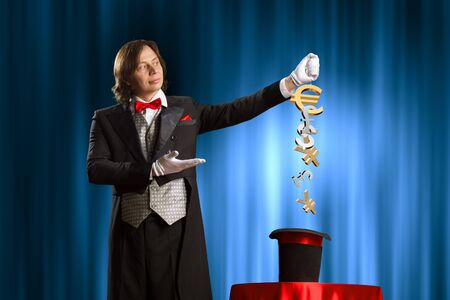 appear: Image of wizard showing tricks with his hat  Currency concept Stock Photo