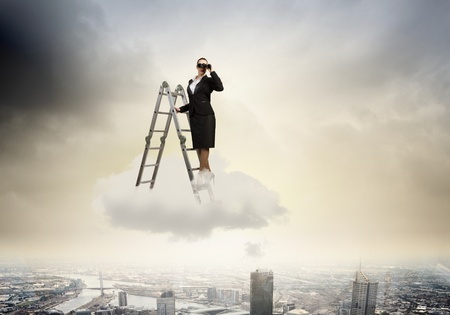 Image of businesswoman standing on ladder and looking in binoculars