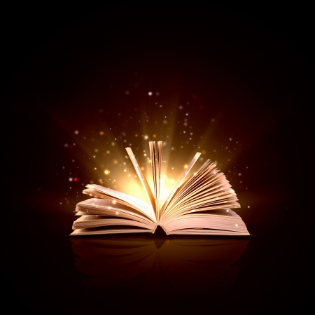 Image of opened magic book with magic lights 版權商用圖片
