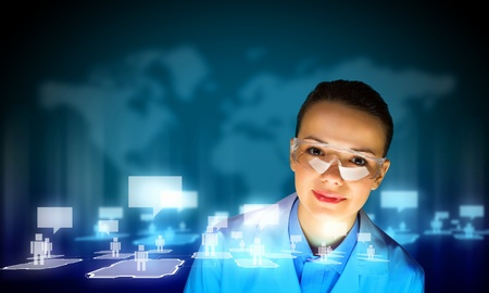 Image of young woman scientist in goggles against media screen  Net communication photo