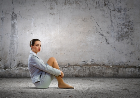 Image of young upset businesswoman sitting alone photo