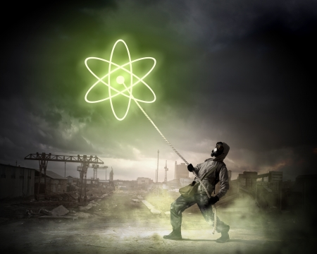 Stalker against nuclear background  Disaster and pollution photo