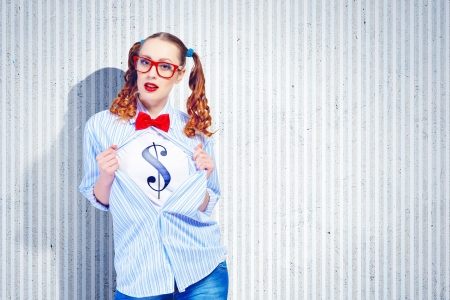 Young woman acting like super hero with dollar sign on chest photo