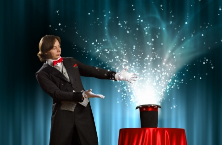 going out: Image of magician holding hat with lights and fumes going out