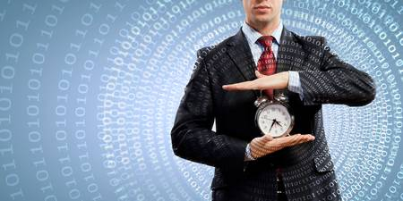 alarmclock: Image of businessman holding alarmclock against illustration background