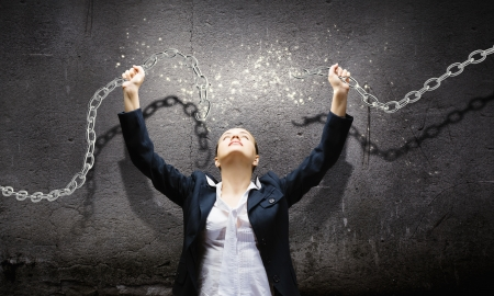 rigidity: Image of businesswoman in anger breaking metal chain