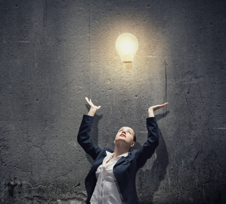 Image of businesswoman and electrical bulb  New idea photo
