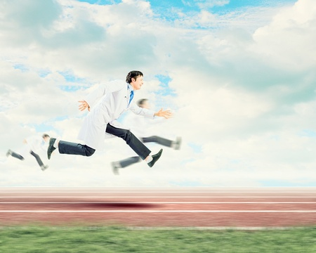paramedical: Funny image of young running doctor in white uniform