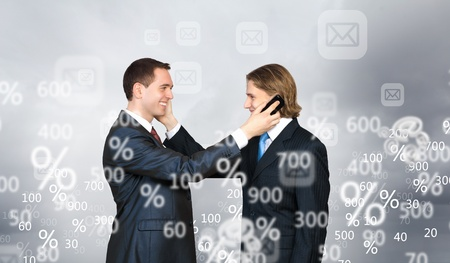 Two businessmen talking on mobile phone  Cooperation concept photo
