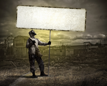 Image of stalker with blank banner against nuclear future Stock Photo - 22040174