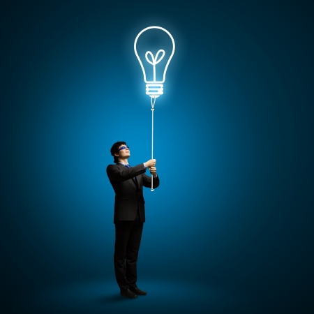 Image of businessman with bulb balloon  Inspiration concept photo