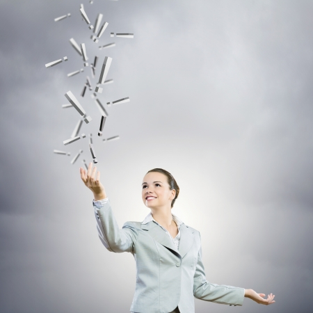 Image of businesswoman holding exclamation marks in hand photo