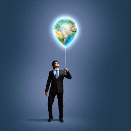 Image of businessman in goggles holding globe  Protect planet  photo