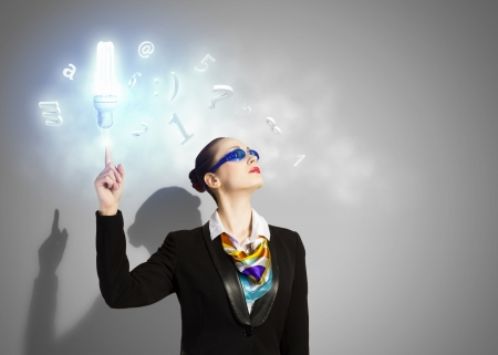 Image of businesswoman in goggles with business collage at background  Idea concept photo