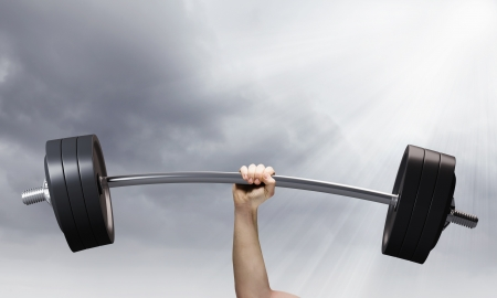 determinism: Lifting barbell above head  Strength and power Stock Photo