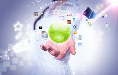 holography: Image of globe on palm of businesswoman  Media technologies
