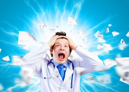 Image of young male doctor screaming in madness photo