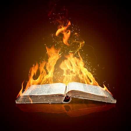 burning paper: Image of magic book in flames of fire
