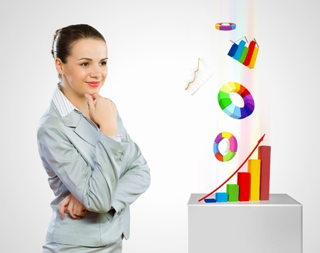 economic growth: Image of thoughtful businesswoman looking at diagrams  Analyzing and marketing