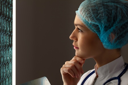 Image of attractive woman doctor looking at x-ray results photo
