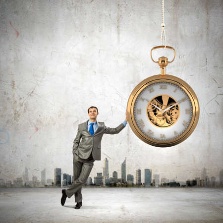 Image of young businessman and pocket watch  Time concept Stock Photo
