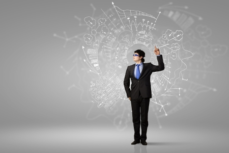 new idea: Image of young businessman wearing goggles  Idea concept Stock Photo