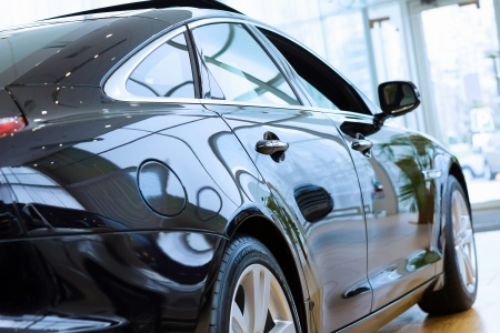 Back view of automobile in sales salon Stock Photo