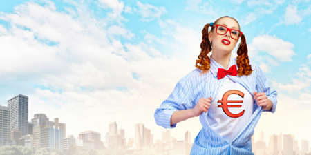 Young woman acting like super hero with euro sign on chest photo