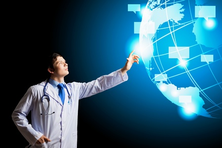 Image of young doctor touching media screen photo