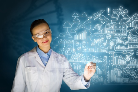 Young woman researcher in medical uniform drawing chemistry formulas photo
